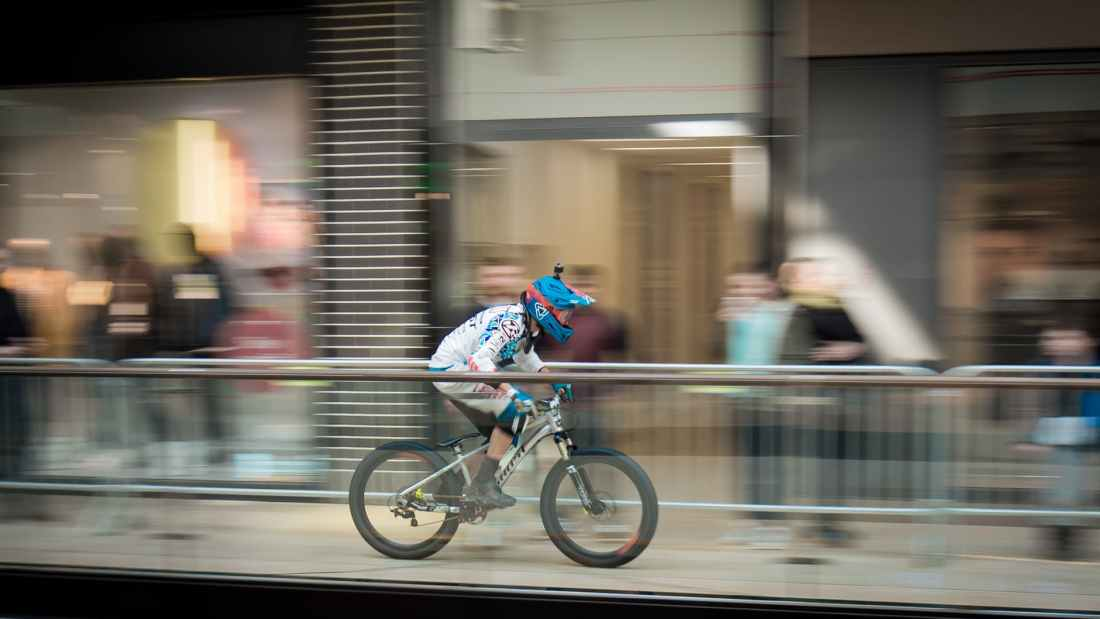 time lapse photography of man riding bicycle